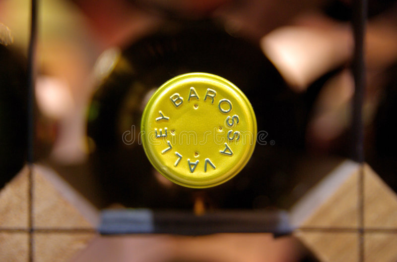 Top Wine. The inscription on the golden cap on top of a Barossa Valley wine bottle as it rests in a wine rack. In a winery in Adelaide, South Australia