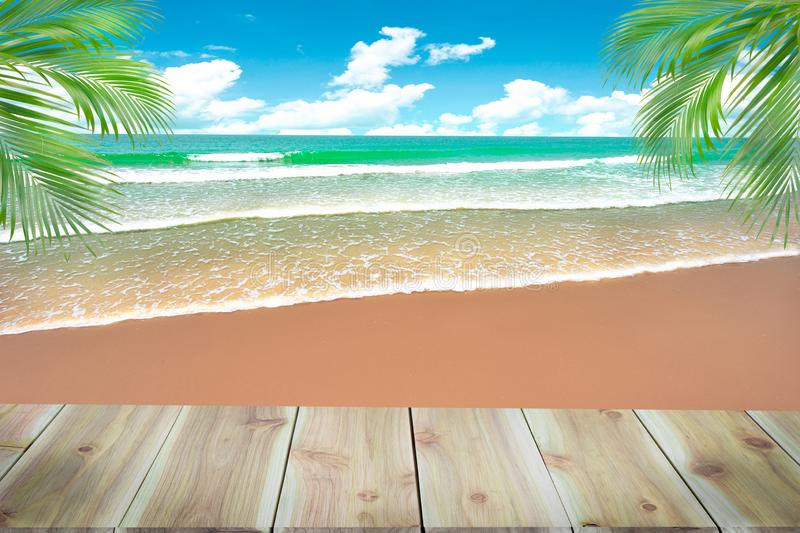 Top of wood table with blurred sea and coconut tree background - royalty free stock image