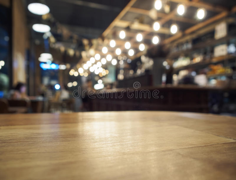 Top of Wooden table with Blurred Bar restaurant background. Top of Wooden table with Blurred Bar Interior restaurant background