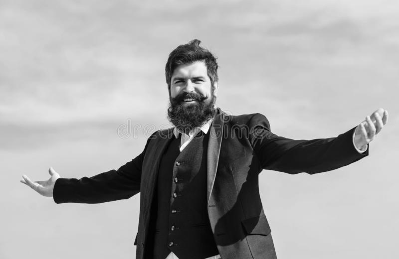 On top of world. Mature hipster with beard. brutal caucasian hipster with moustache. being on top. Businessman against stock images