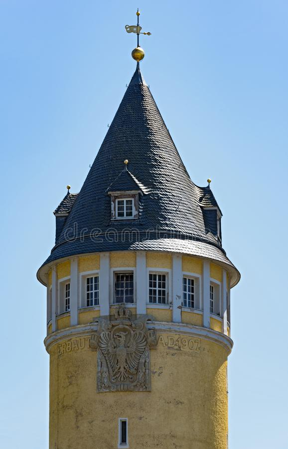 The top of the yellow source tower in Bad Ems, Germany royalty free stock photos