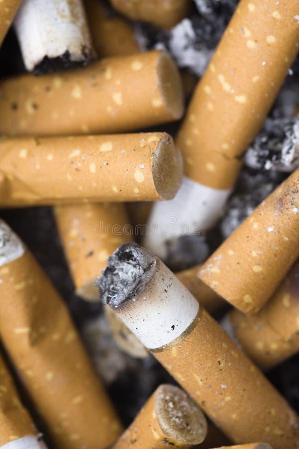 Topes de cigarrillo fotografía de archivo libre de regalías