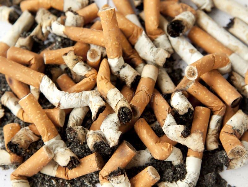 Topes de cigarrillo, fondo foto de archivo
