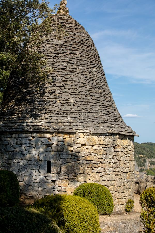 Topiary and stone rotunda in the gardens of the Jardins de Marqueyssac in the Dordogne region of France. Topiary and stone rotunda in the gardens of the Jardins stock photos