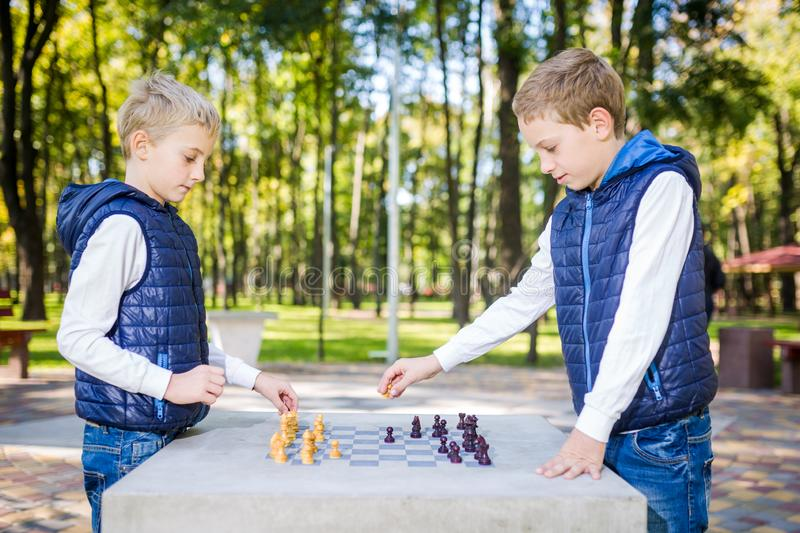 The topic is children learning, logical development, mind math, miscalculation moves advance. Big family two brothers Caucasian stock photos
