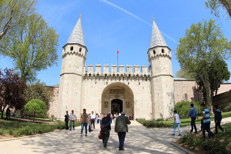 Topkapi Palace Museum, Istanbul in Spring. Tourists in front of the entrance to Topkapi Palace Museum or the Seraglio in Istanbul, Turkey. It`s a large museum stock photography