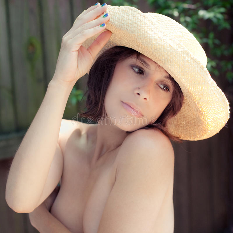 Topless Cowgirl. A portrait of a topless woman in a cowboy hat stock photos