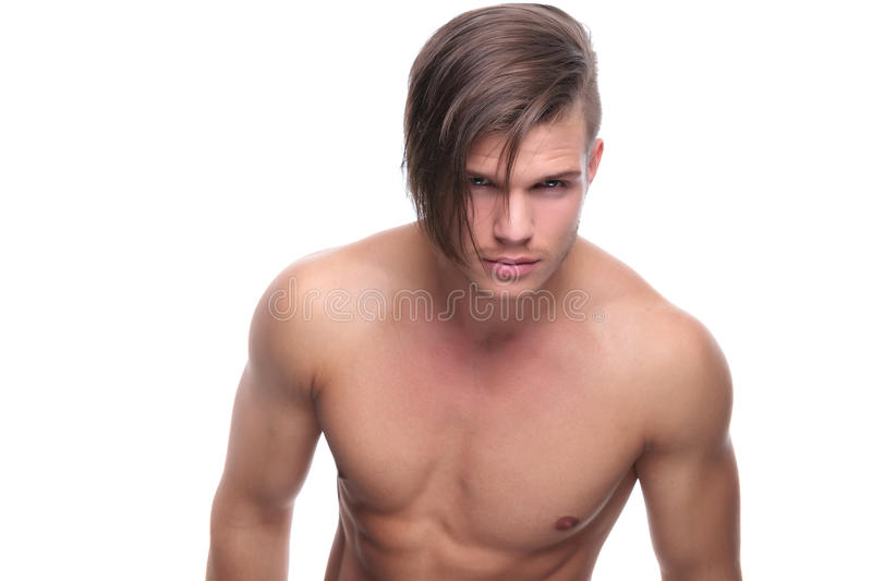 Topless fashion man looks into your eyes. Young fashion topless man looking deep into your eyes. isolated on white background royalty free stock photo