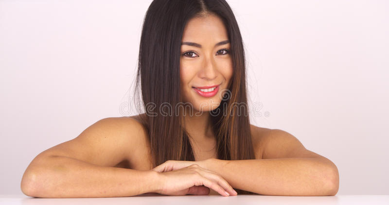 Topless Japanese woman looking at camera royalty free stock photography