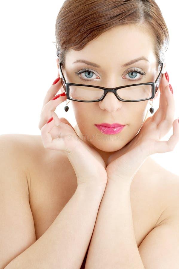Topless lady in black plastic eyeglasses stock images
