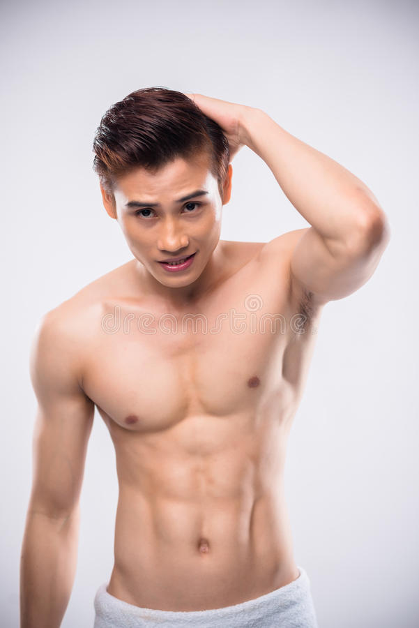 Topless man. Attractive topless Asian guy looking at camera royalty free stock images