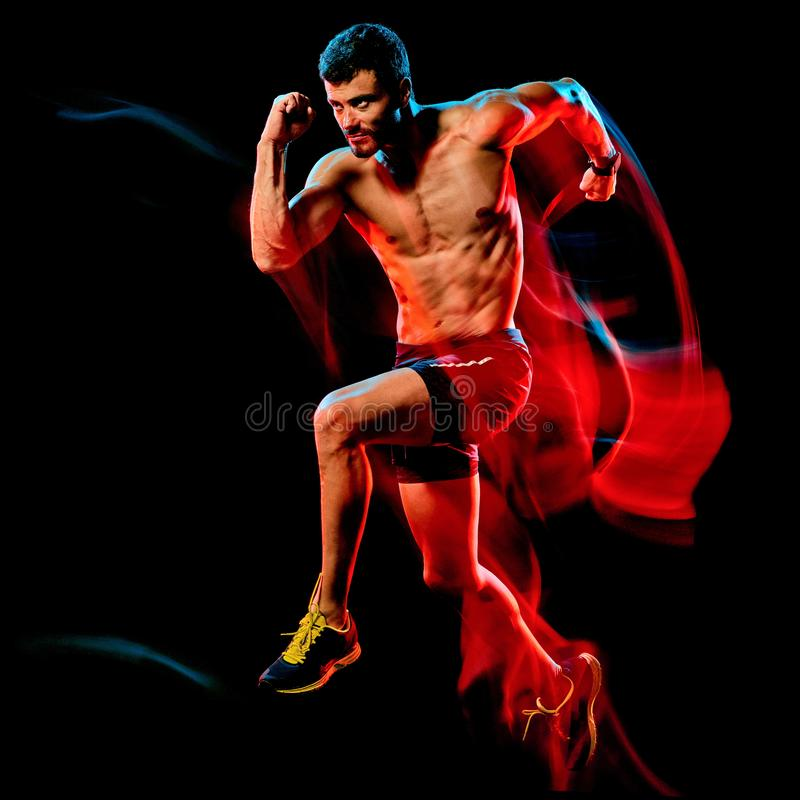 Topless muscular man runner. running jogger jogging isolated black background royalty free stock photography