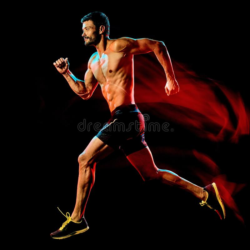 Topless muscular man runner. running jogger jogging isolated black background stock photography