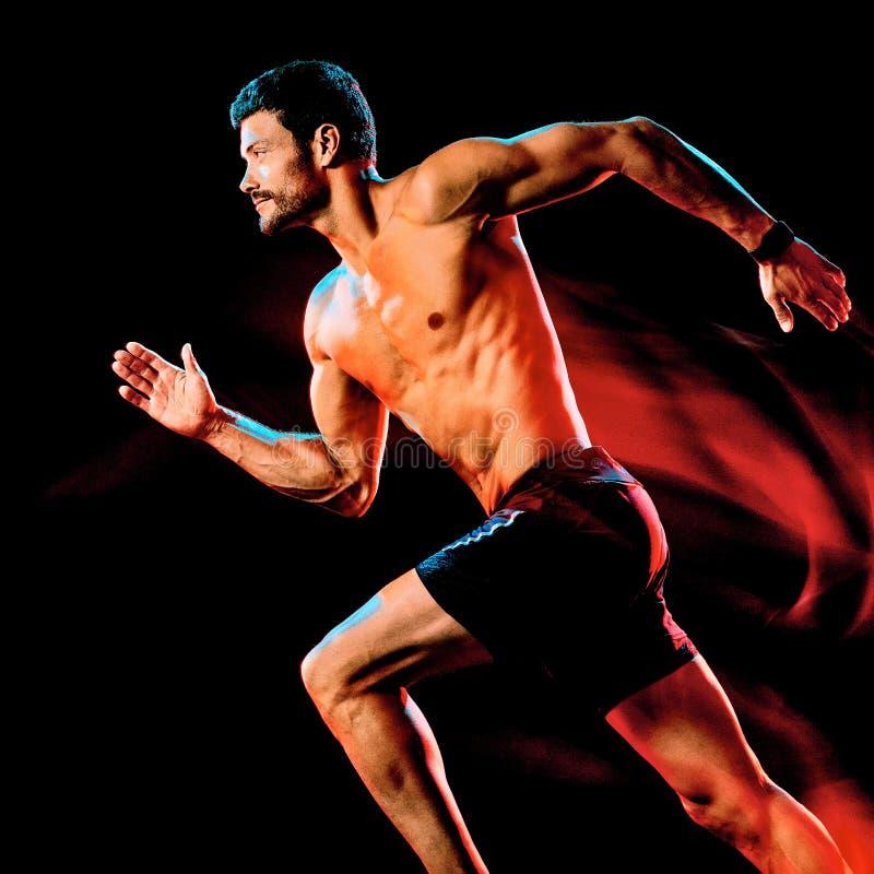 Topless muskulös manlöpare körande jogger som joggar isolerad svart bakgrund arkivbild