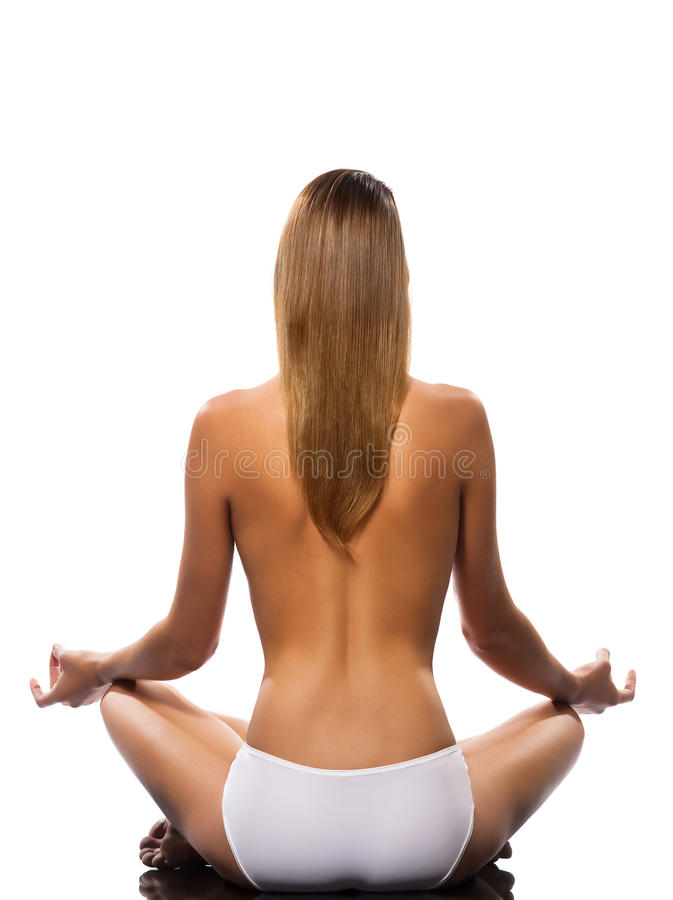 Topless woman meditating stock photos