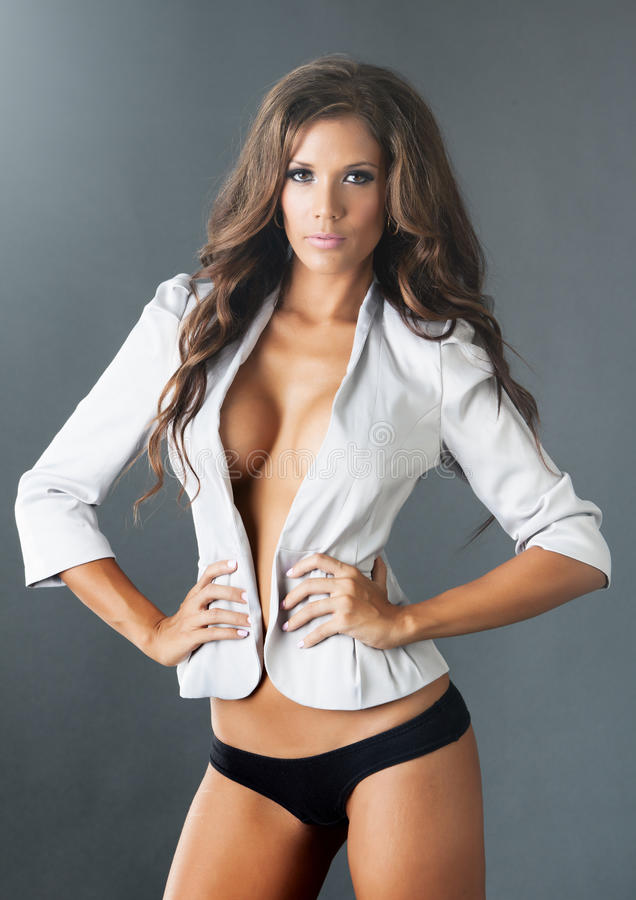 Topless woman in white jacket with cleavage. Topless young woman in white jacket with cleavage stock photos