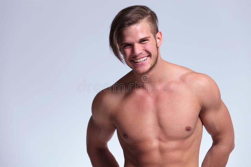 Topless young man shows a big smile royalty free stock photography