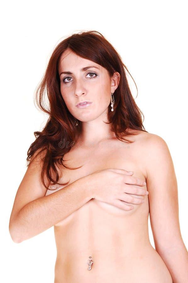 Toplesse Frau, die oben abdeckt. stockfotografie