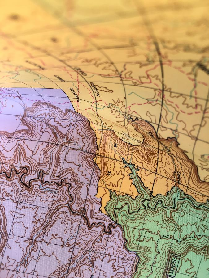 Topographic map with iso-lines, rivers and background. Closeup stock photo