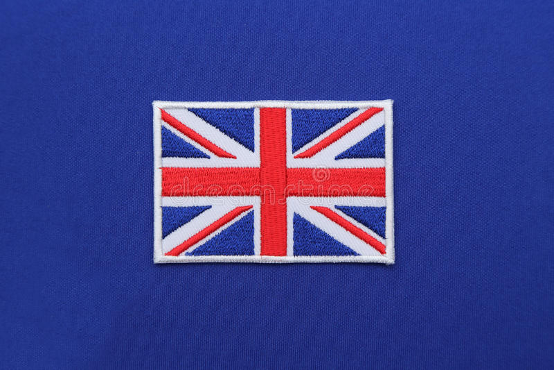 Toppa britannica della bandiera su tessuto immagine stock libera da diritti