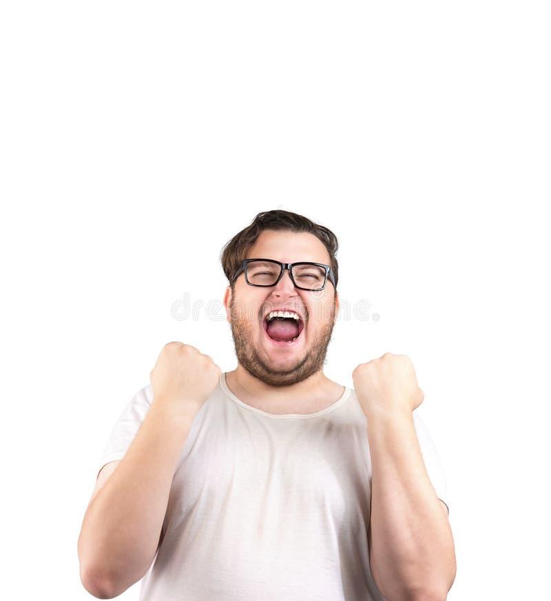 Toppen lycklig man spännande med seger arkivfoton