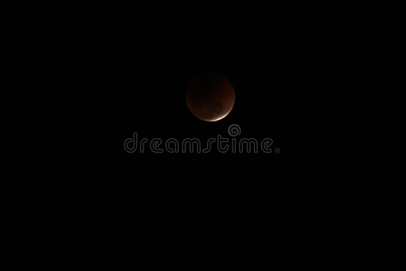 Toppen måne och månförmörkelse för blått blod arkivfoto
