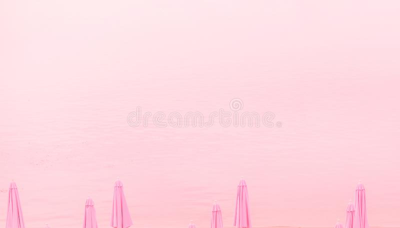 tops beach umbrellas pink background place inscription royalty free stock photo