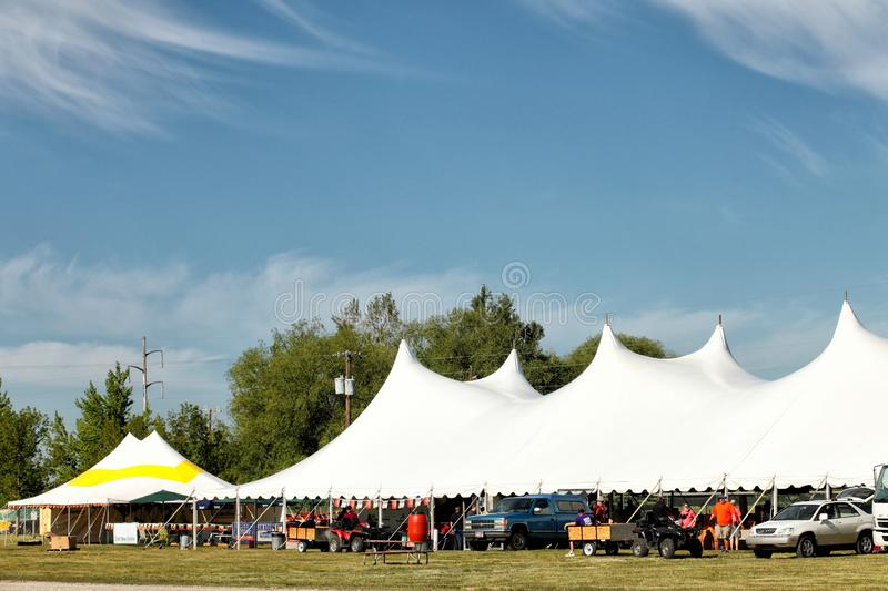 Rental party tents set up at an event. The tops of a series of party tents set up for a commercial sales event royalty free stock images