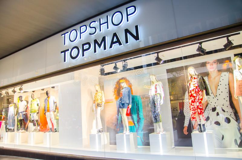 Topshop Topman fashion clothing and accessories retail store, the image shows shopfront at night. royalty free stock image