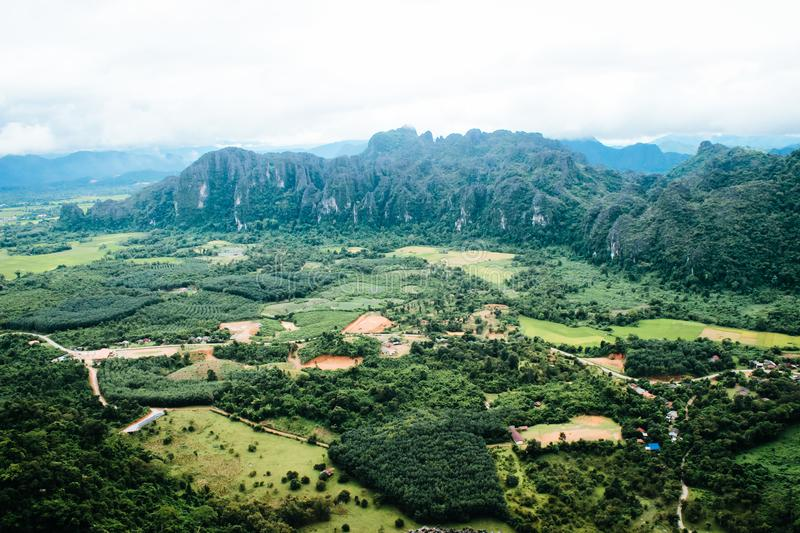 City view and mountains from Pha Ngern cliff in Vang Vieng, Lao royalty free stock images