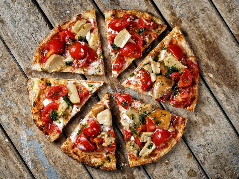 Topview sliced round pizza mushrooms tomatoes royalty free stock image