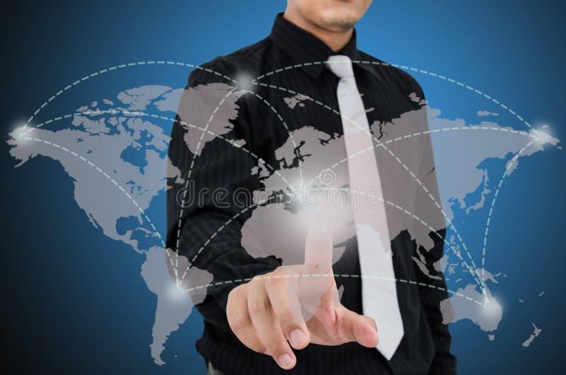 Toque do homem de negócio no mapa virtual imagem de stock