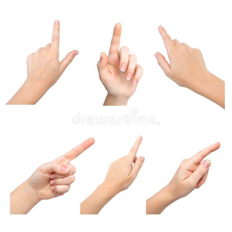 toque fêmea das mãos a algo fotos de stock
