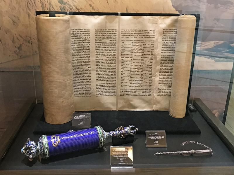Torah Scroll and a Blue Scroll of Esther. Williamstown, KY, USA - November 3, 2017: Torah Scroll in the 1800`s plus a blue scroll of Esther in Noah`s ark replica royalty free stock image