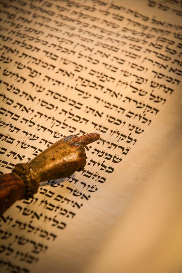 Torah scroll. With a yad pointer stock photos