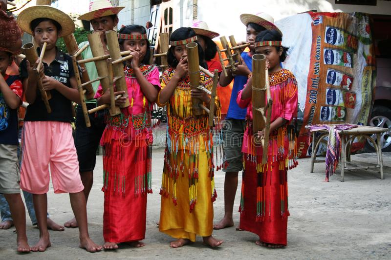 Toraja children. Are playing traditional music in a orphanage at sulawesi island in indonesia stock photo