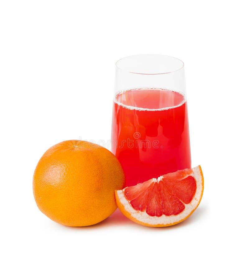Toranjas (grapefruits) e vidro de suco imagem de stock