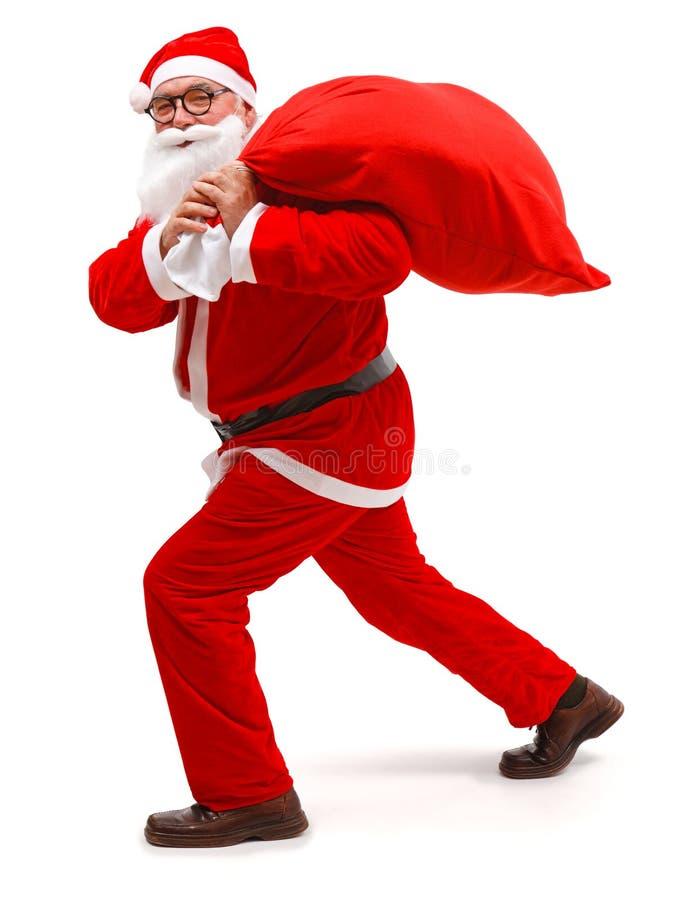 torby Claus folujący Santa odprowadzenie fotografia stock
