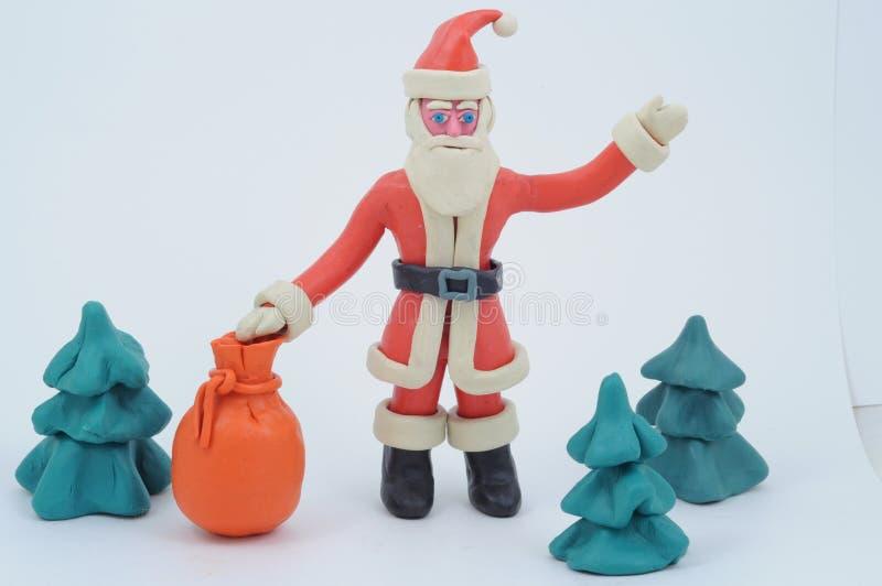 torby Claus prezentów plastelina Santa fotografia royalty free