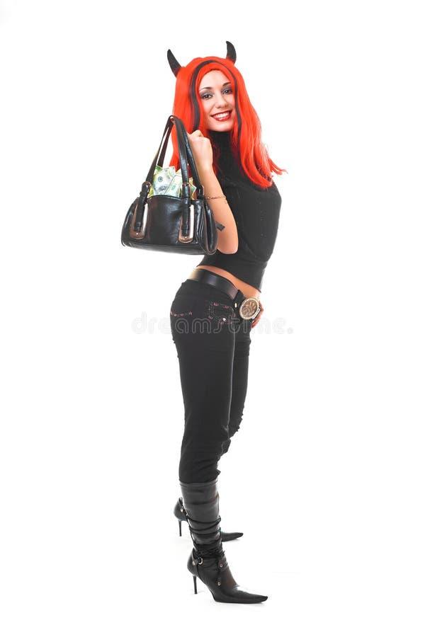 torby dziewczyny pieniądze diabelska czerwony obraz royalty free