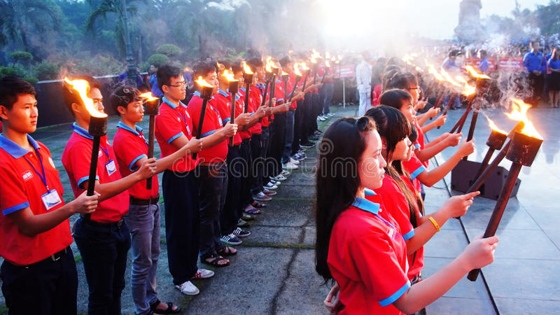 Torch in ceremony. HO CHI MINH CITY , VIETNAM- JULY 26: Crowd of people standing, hold torch in July 27 event, ceremony to commenorate heroic that sacrifice in royalty free stock images