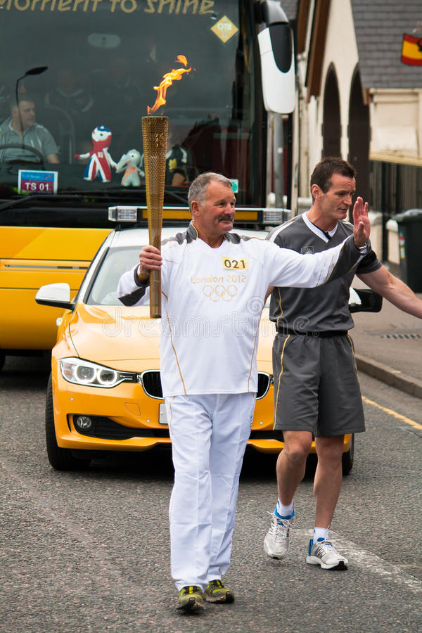 Torchbearer olympique images stock