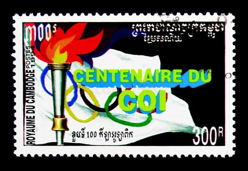 Torche olympique, 100 ans du serie olympique international de Commettee, vers 1994 image stock