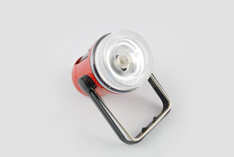 Torcia elettrica di plastica portatile con priorità bassa bianca fotografia stock libera da diritti