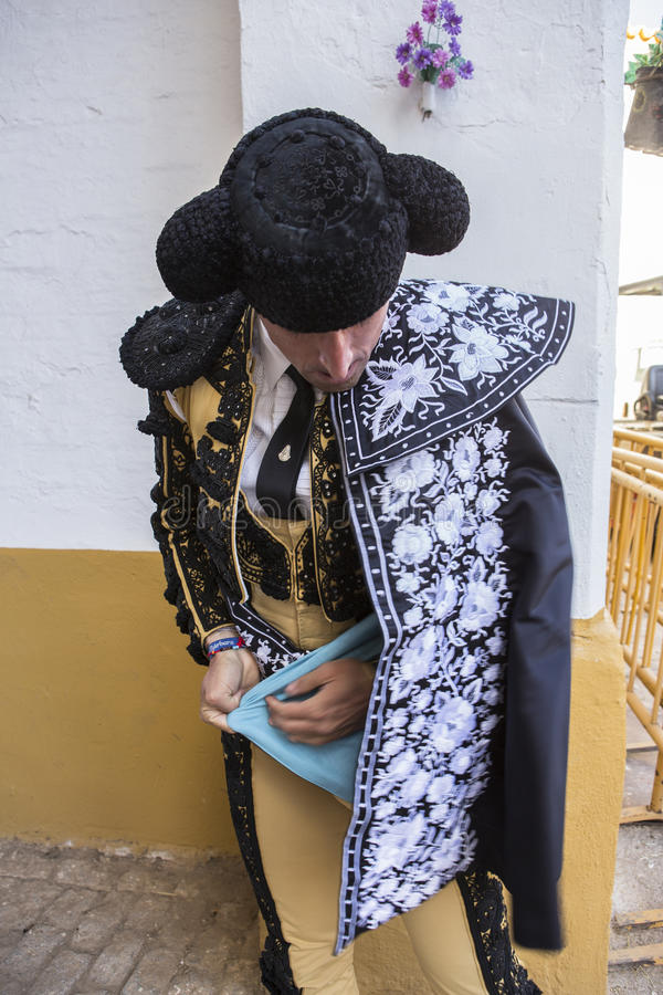 Toreador putting itself the walk cape in the alley before going out to fight, typical and very ancient tradition in Linares, Jaen royalty free stock photo