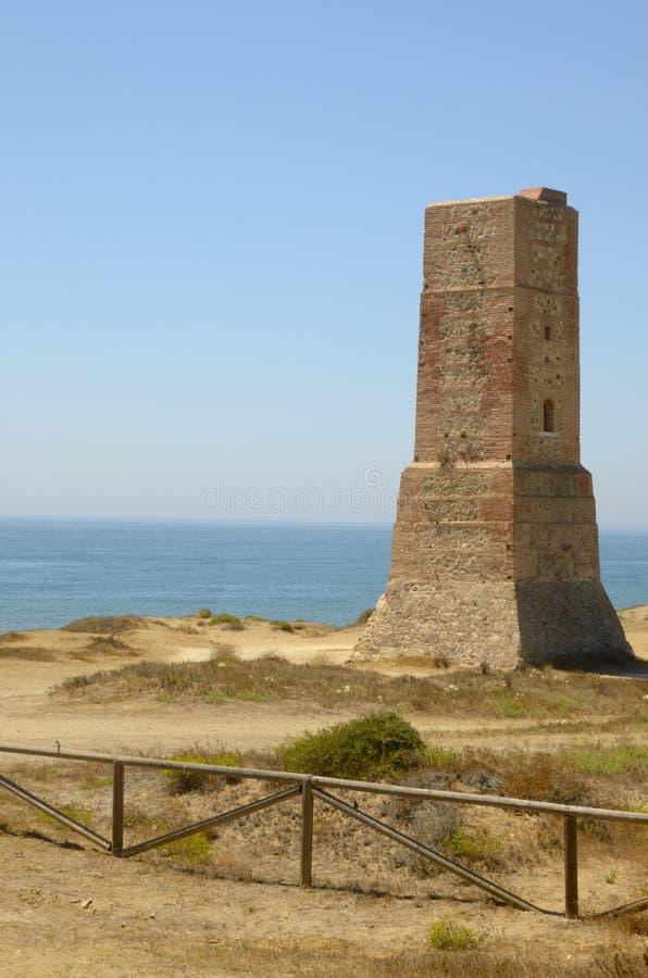 Toren in strand Cabopino stock afbeeldingen