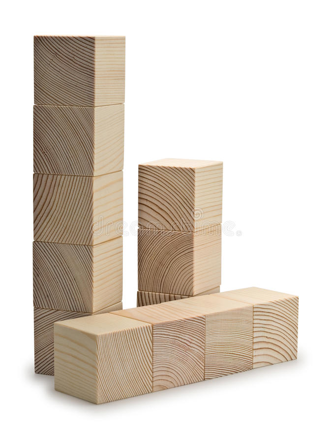 Torentjes en de kolommen van houten kubussen worden gecombineerd die stock fotografie