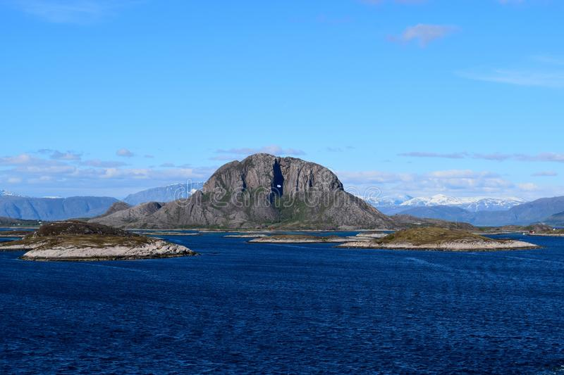 Torghatten with a large hole through royalty free stock image