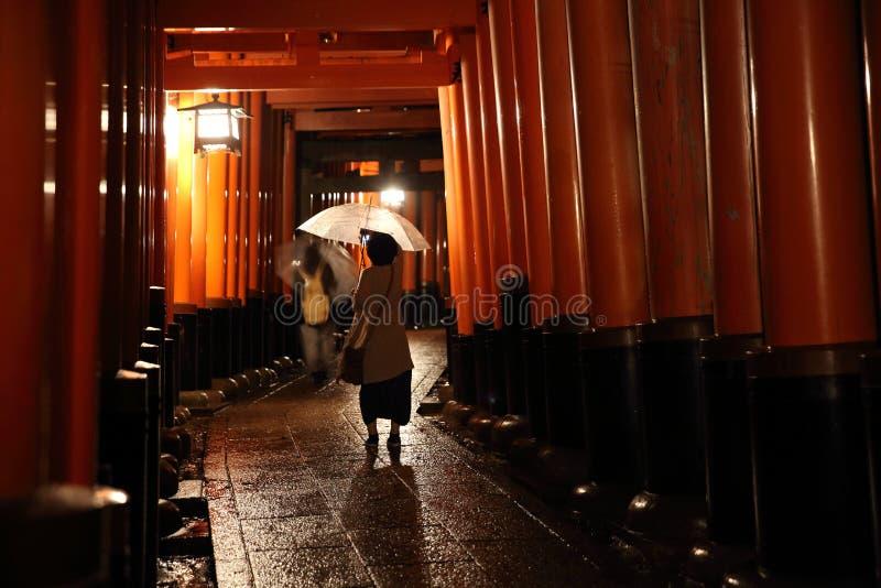 Tori gates in Fushimi Inari Shrine at night with selective focus , Kyoto, Japan royalty free stock photos