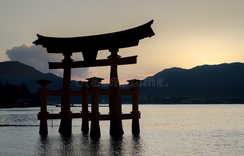 Torii - floating gate of Miyajima Itsukushima island at sunset time. Japan royalty free stock image